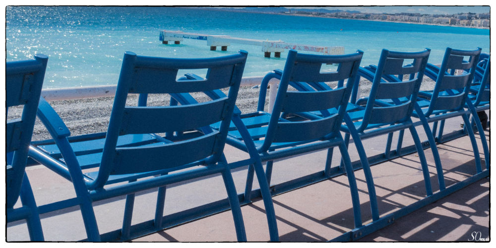 The blue chairs of the Promenade des Anglais